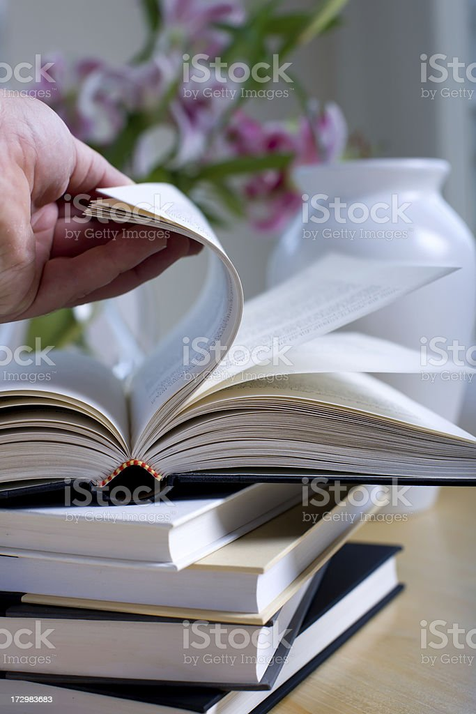 browsing a book royalty-free stock photo