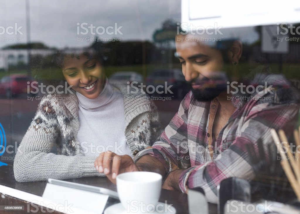 Browsing a Digital Tablet in a Cafe stock photo