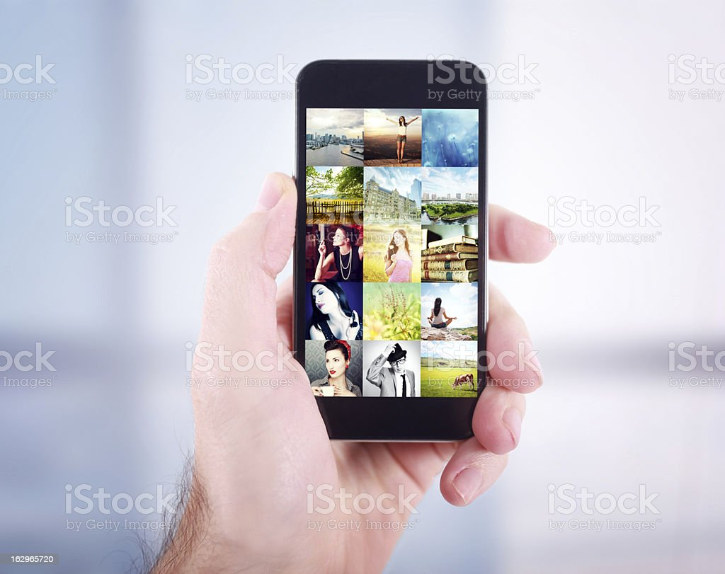 Browsing a photo gallery on smartphone stock photo
