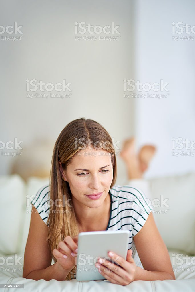 Browsing from a comfy couch stock photo