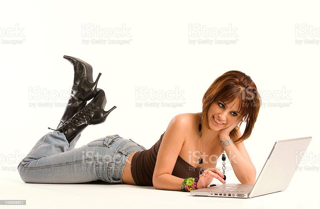 Browsing her Laptop royalty-free stock photo