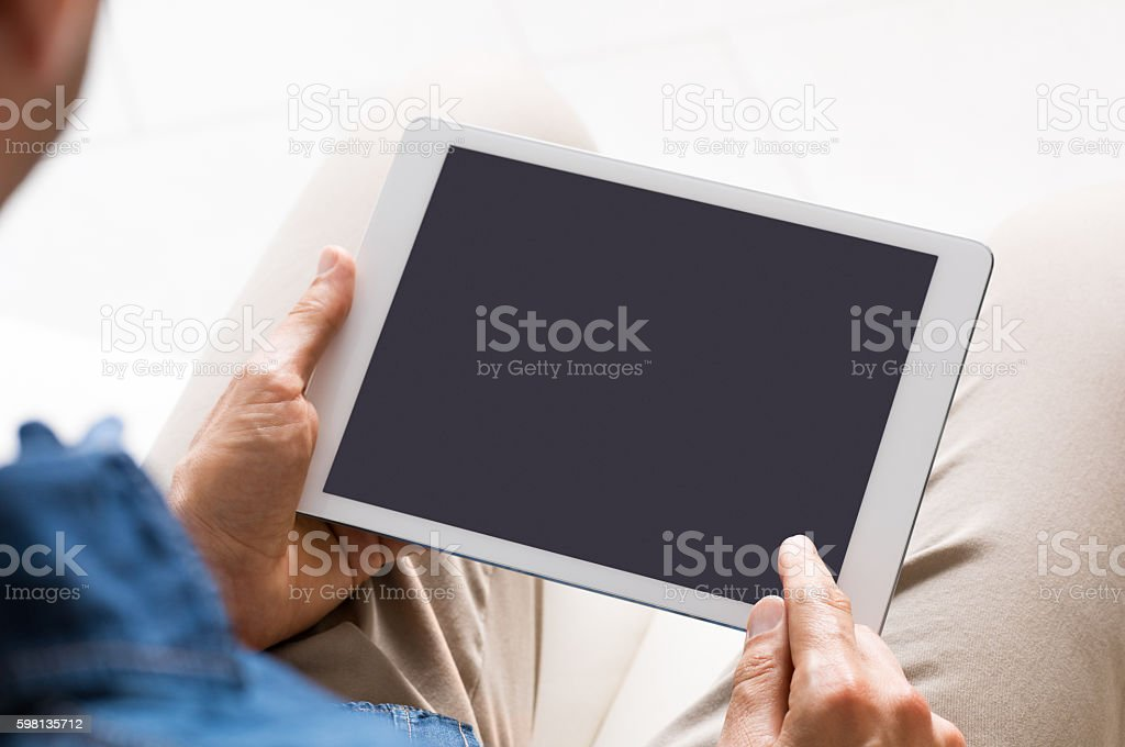 Browsing on tablet stock photo