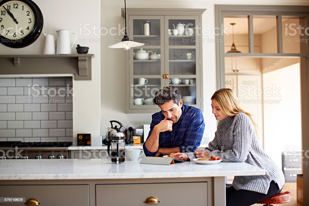 Browsing over breakfast stock photo