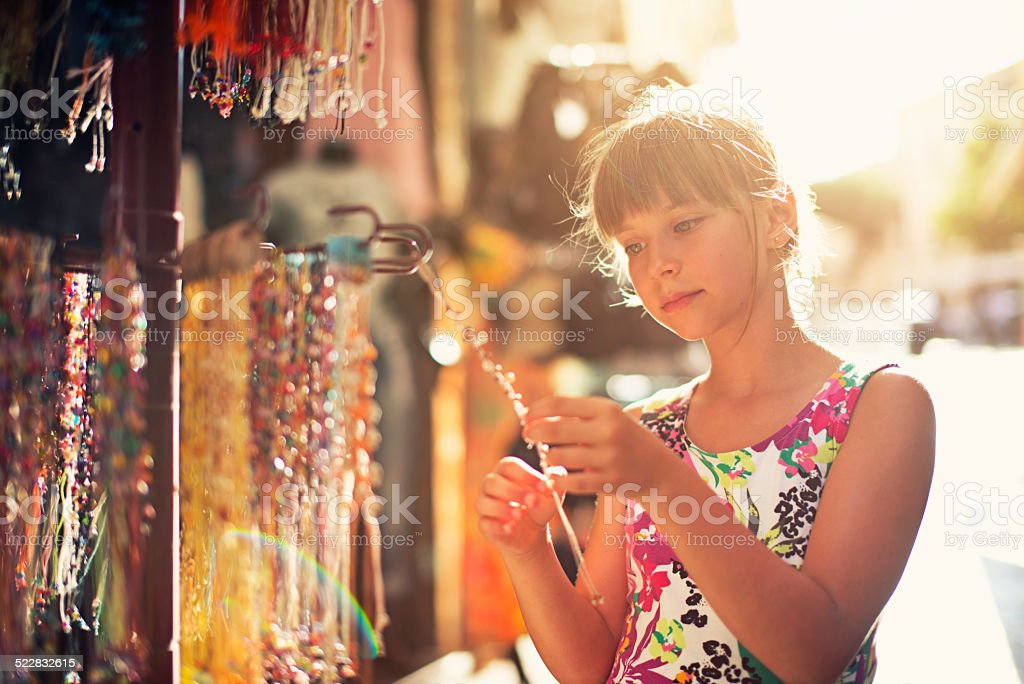 Browsing street jewelry stand stock photo