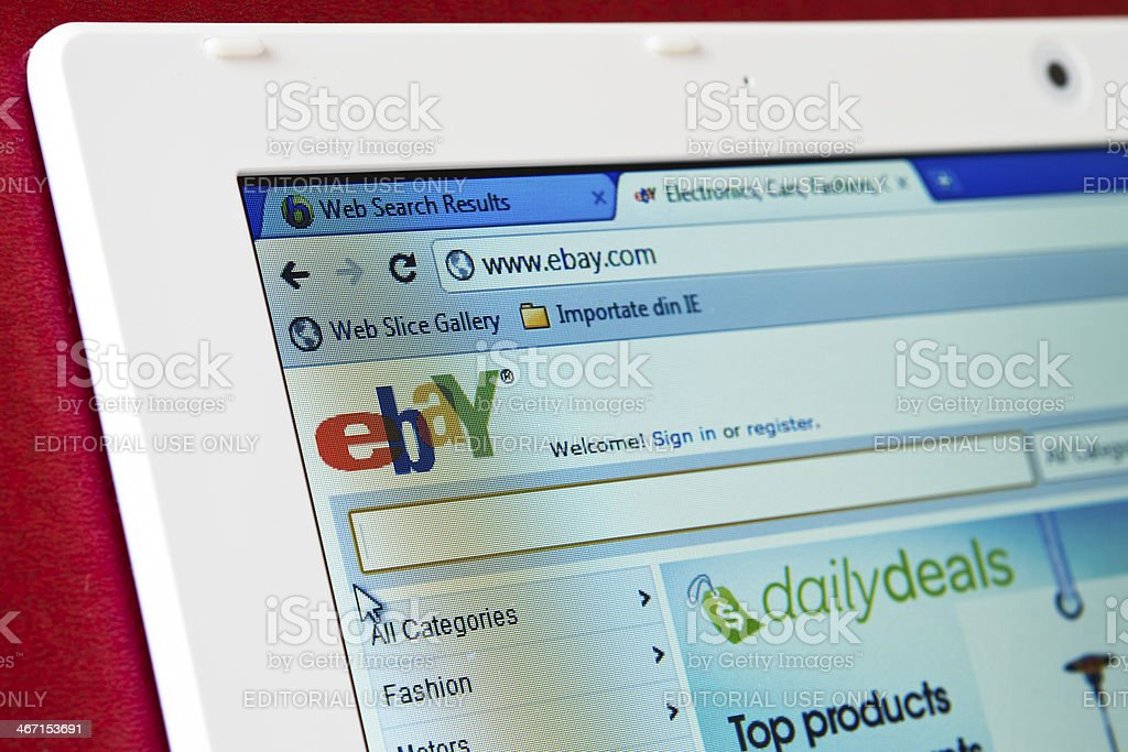 Browsing the ebay webpage on laptop computer stock photo
