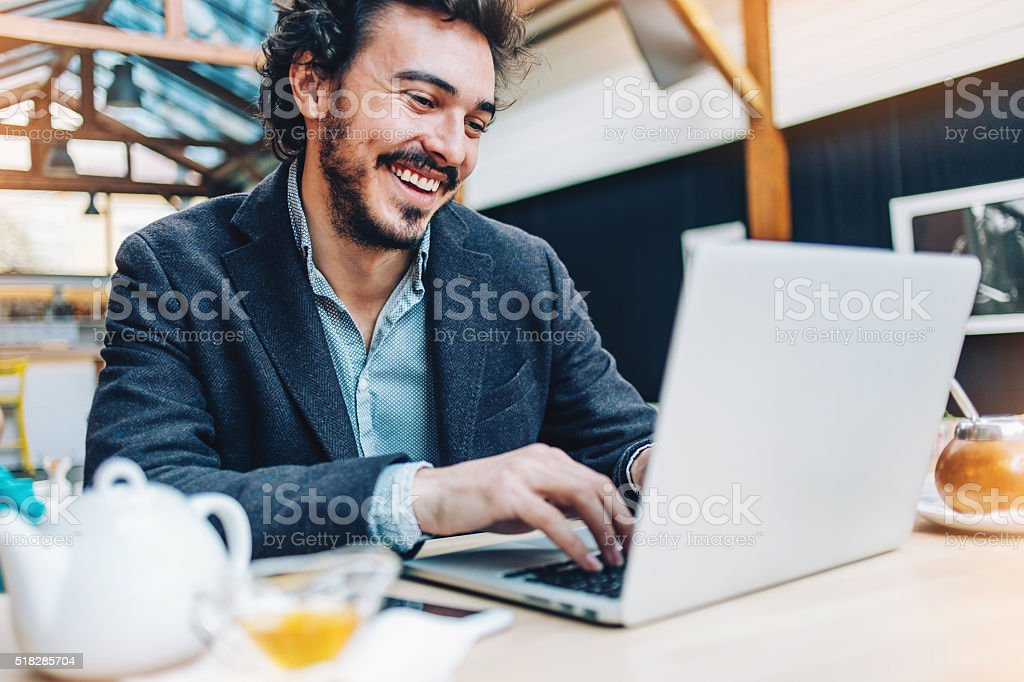 Browsing the net in the coffee shop stock photo