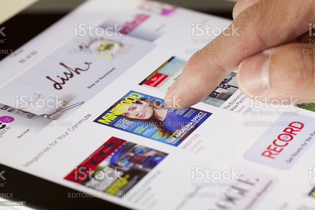 Browsing the Newsstand in iOS 7 royalty-free stock photo