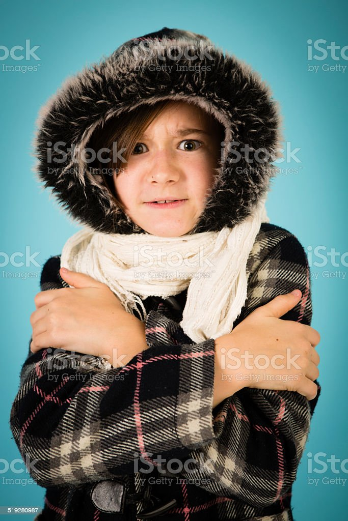 Brrrr! Young Girl Dressed in Warm Clothing stock photo
