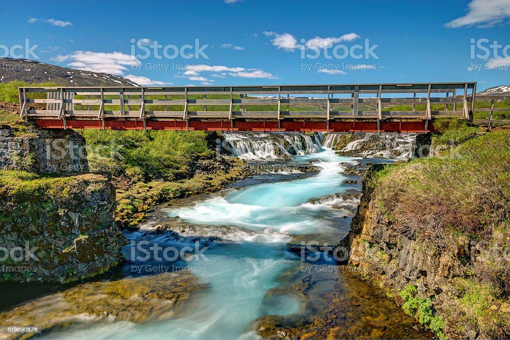 Bruarfoss waterfall with footbridge stock photo