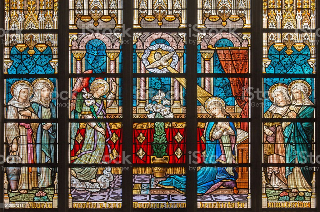 Bruges - Annunciation on windowpane in St. Salvator's Cathedral stock photo