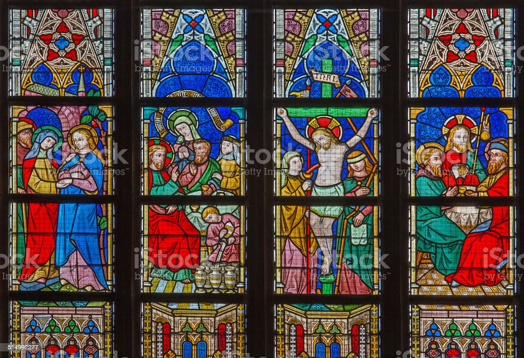 Bruges - Biblical scenes on windowpane in St. Salvator's Cathedral stock photo
