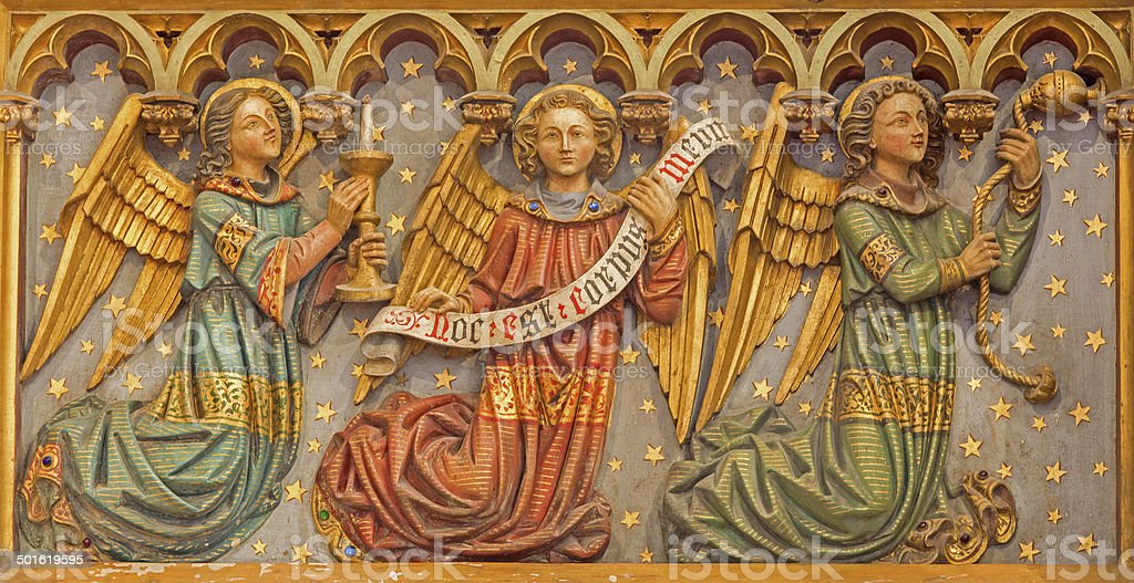 Bruges - Carved neogothic relief of angels Salvator's Cathedral stock photo