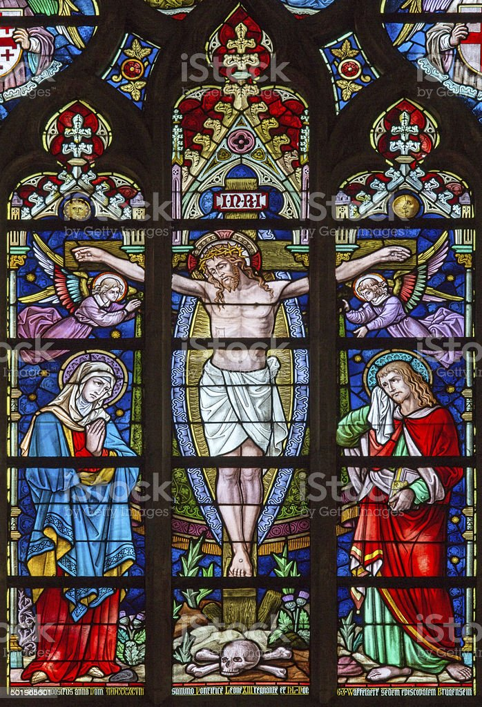 Bruges - Crucifixion on windowpane in Salvator's Cathedral stock photo