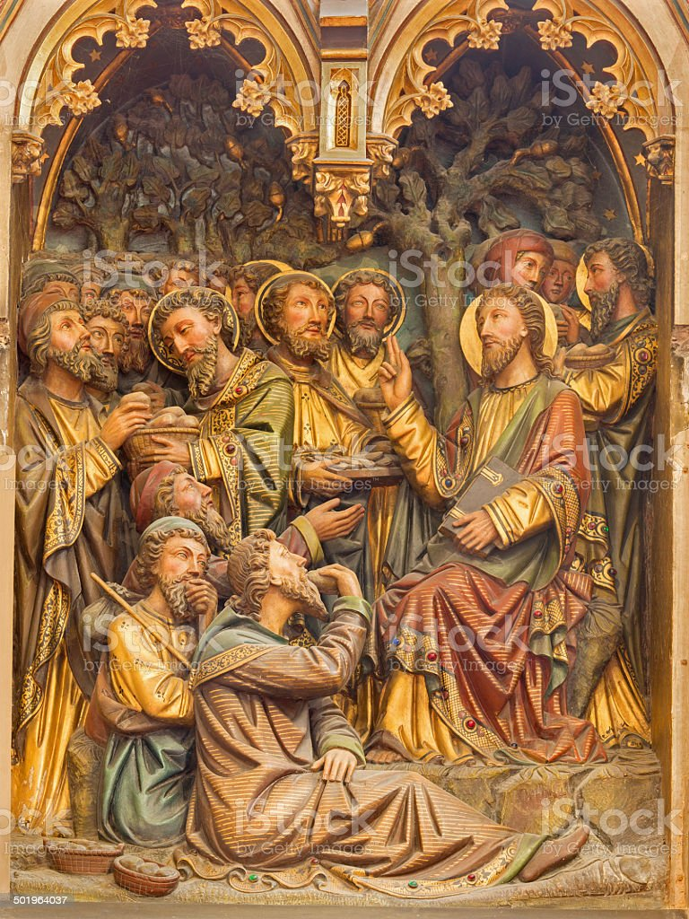Bruges - Miracle of Multiplying Food carved relief stock photo