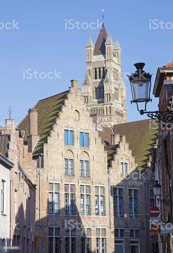 Bruges -  typically brick houses and St. Salvator's Cathedral stock photo