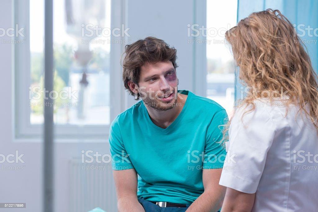 Bruised man flirting with nurse stock photo