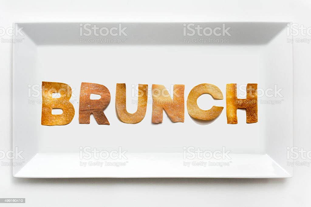 Brunch in pastry letters on white porcelain rectangular plate stock photo