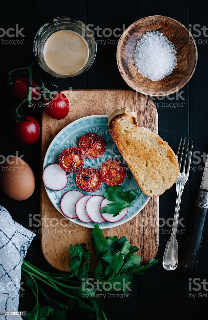 Brunch with tomatoes and radishes stock photo
