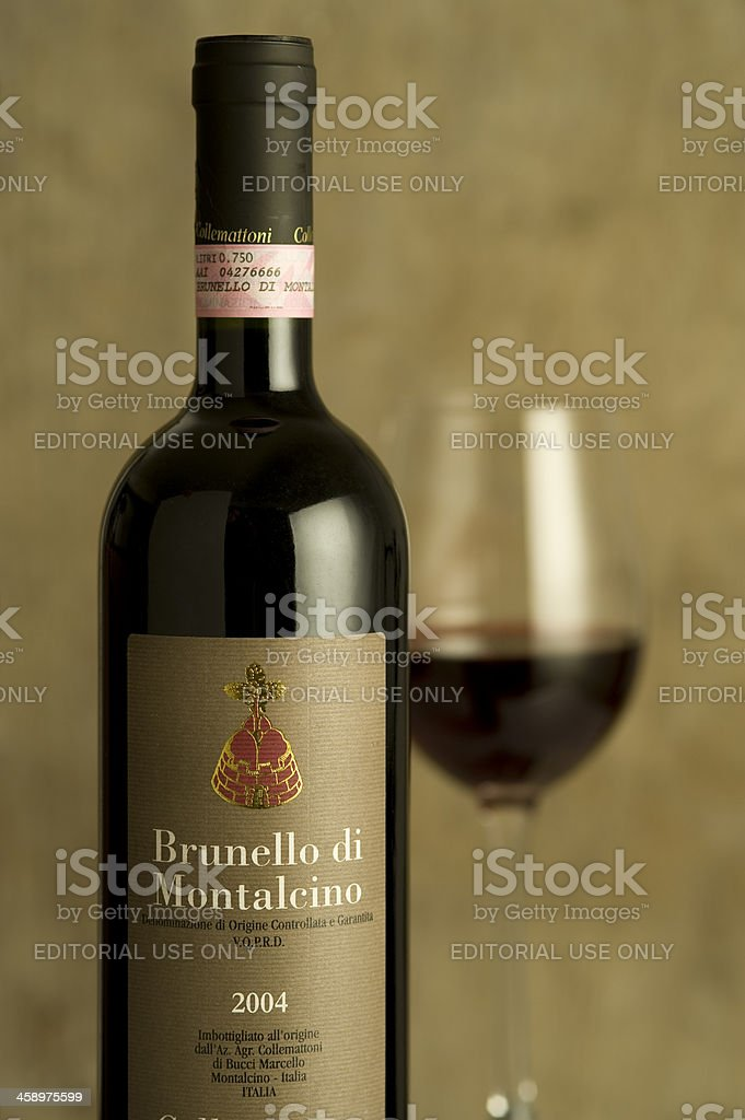 Brunello di Montalcino wine bottle in a diner place setting stock photo