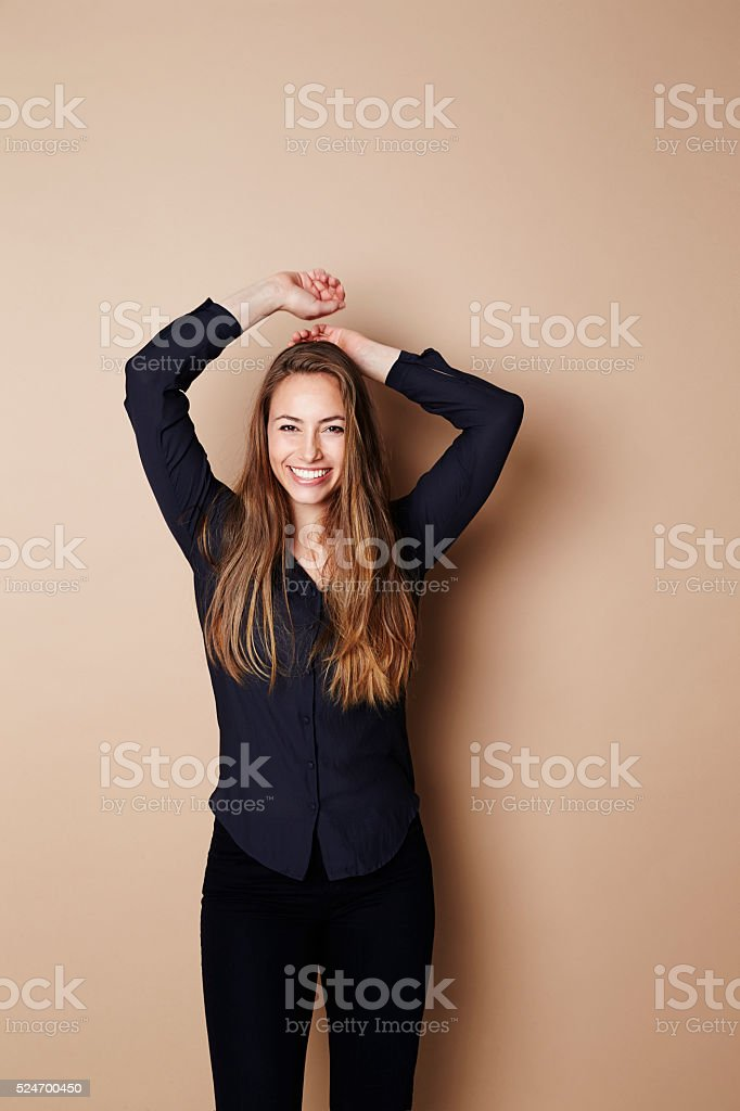 Brunette and beautiful young woman in studio stock photo