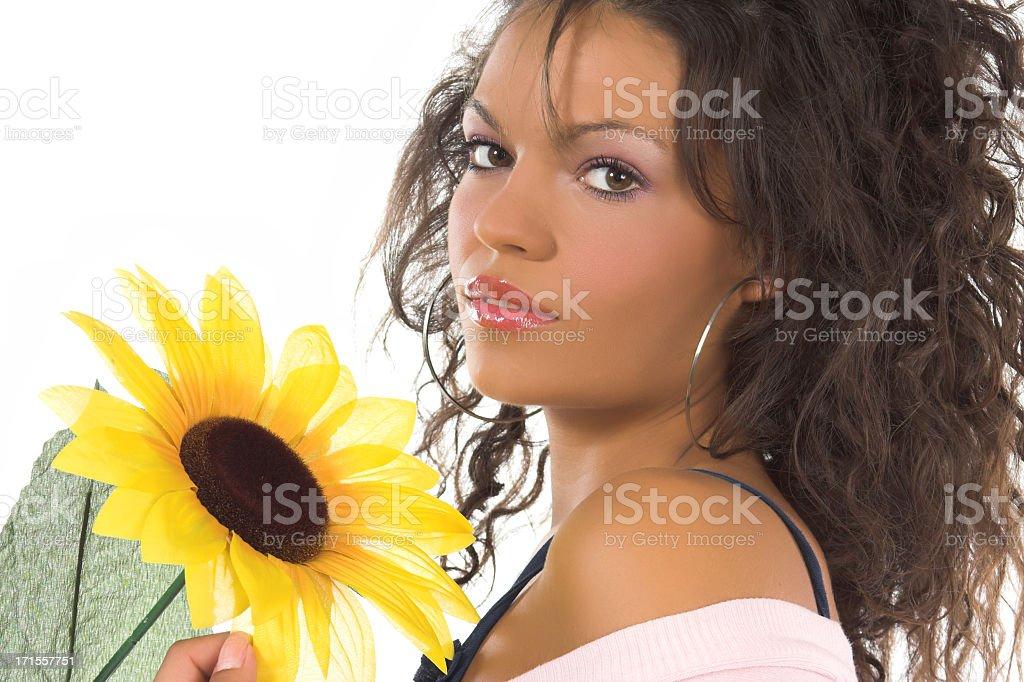 Brunette and sunflower stock photo