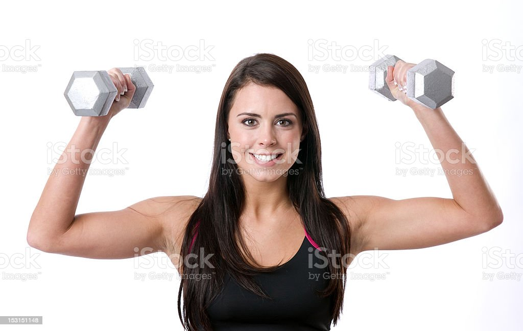 Brunette Barbie Working Out Lifting Barbells Looks Vibrant and Happy royalty-free stock photo