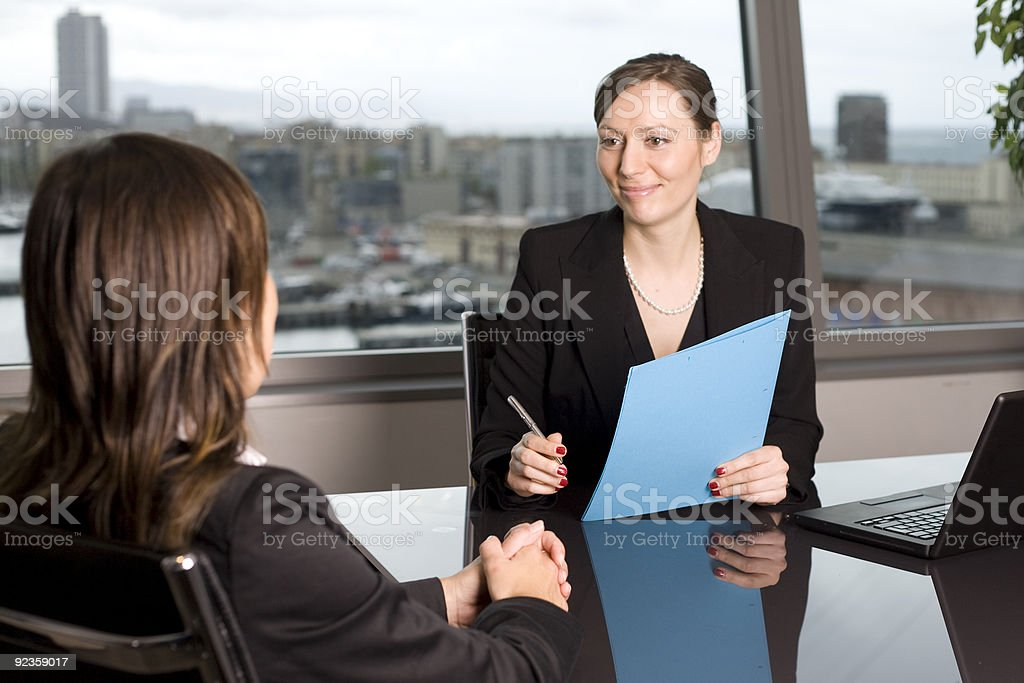 Brunette business woman conducting an interview royalty-free stock photo