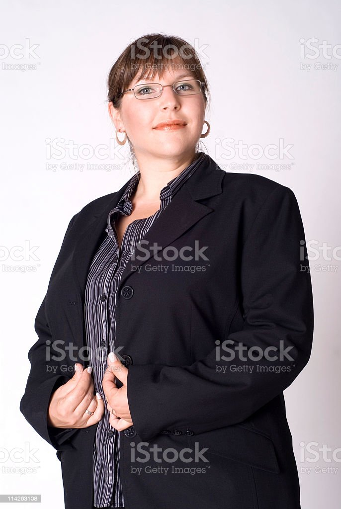 Brunette business woman standing stock photo