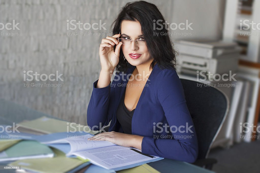Brunette businesswoman take off glasses royalty-free stock photo
