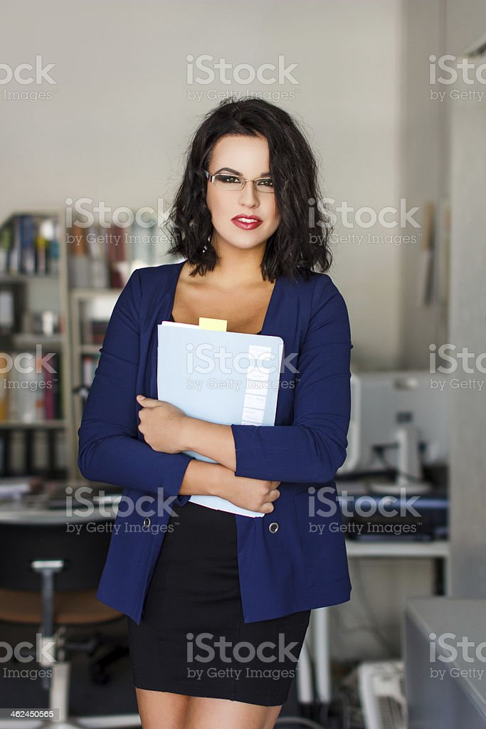 Brunette businesswoman with folder royalty-free stock photo