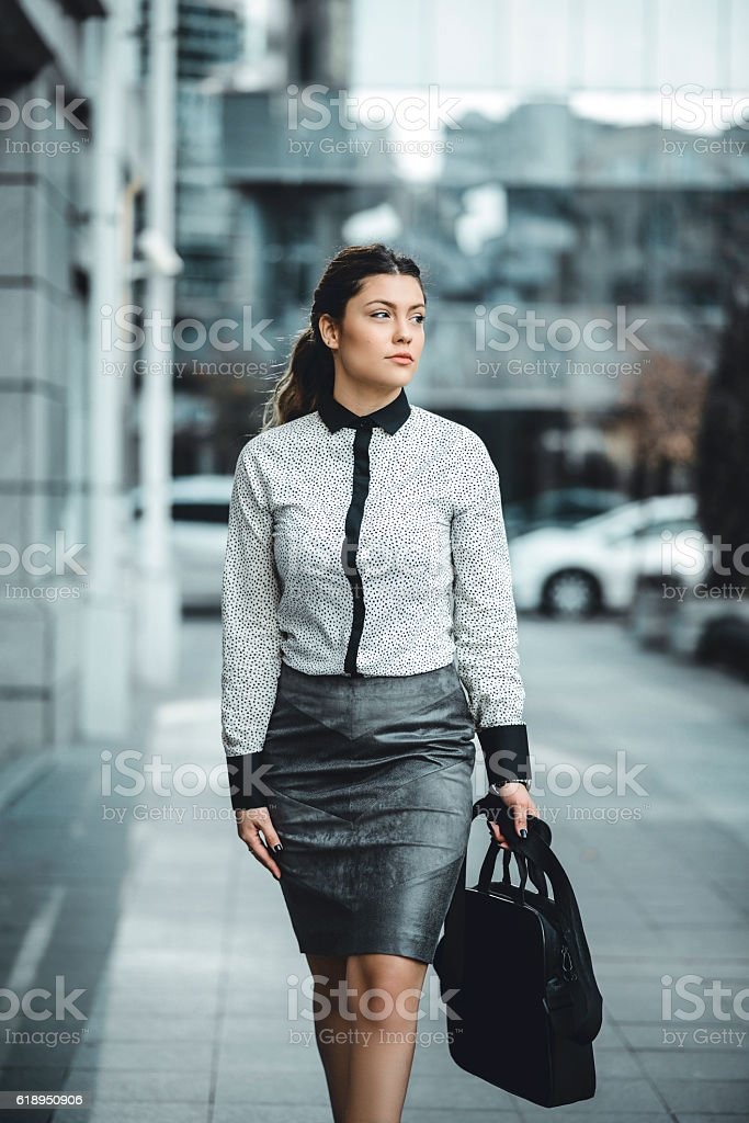 Brunette Businesswoman with LapTop Bag Walking Outdoor on Street stock photo