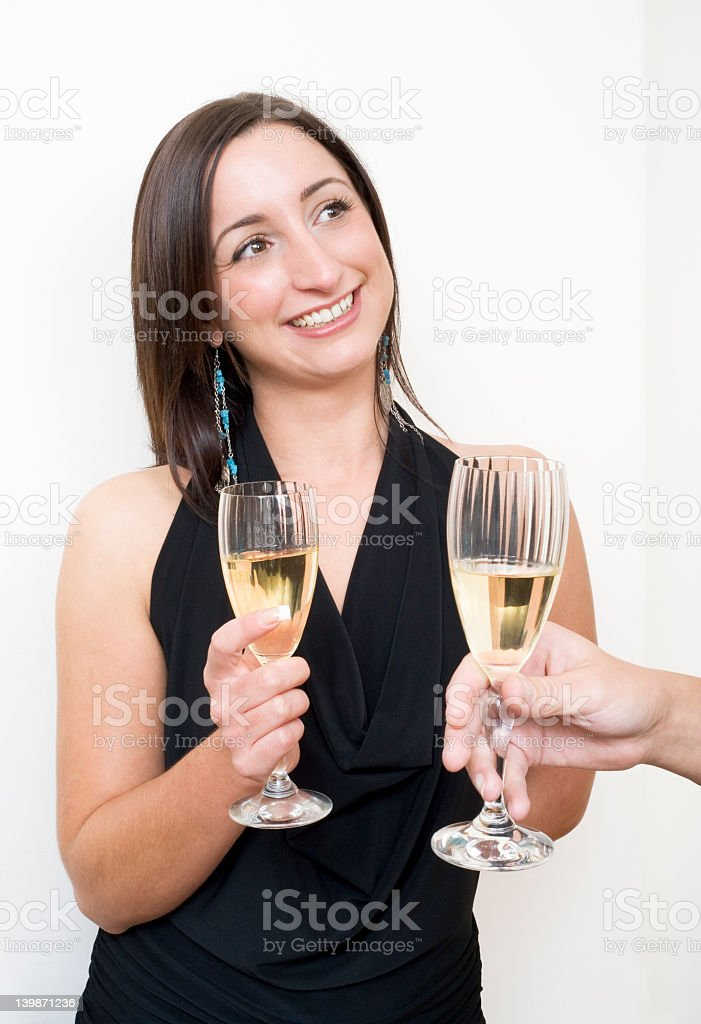 Brunette drinking champagne royalty-free stock photo