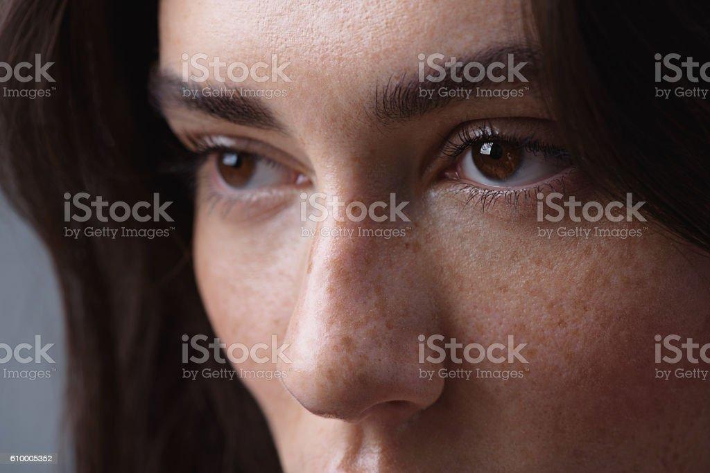 brunette face on the light grey background stock photo