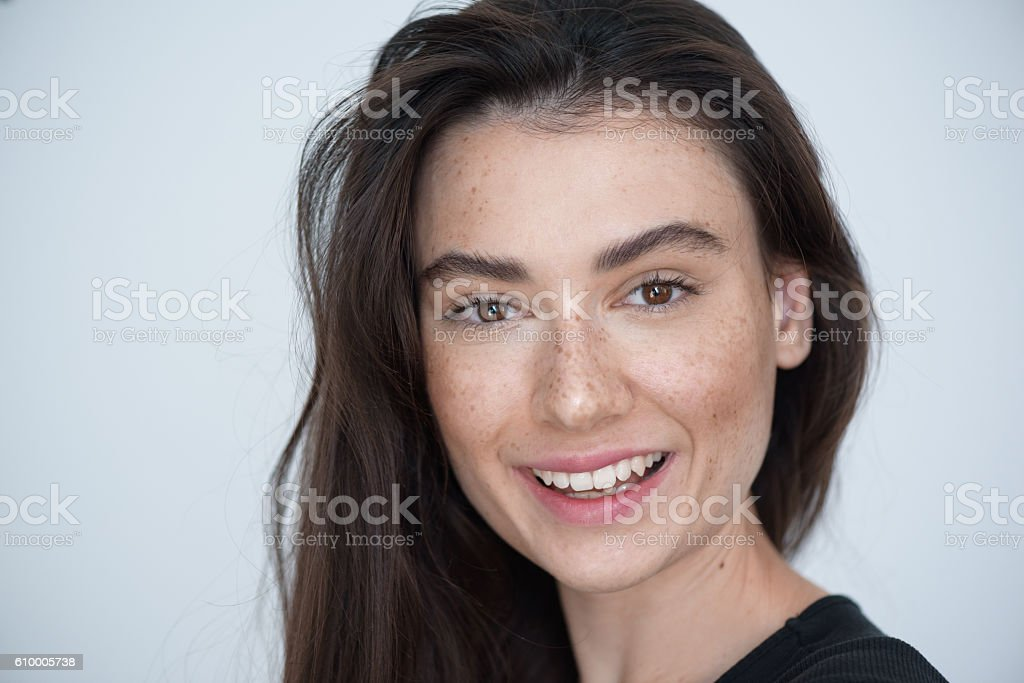brunette face on white background with copyspace stock photo