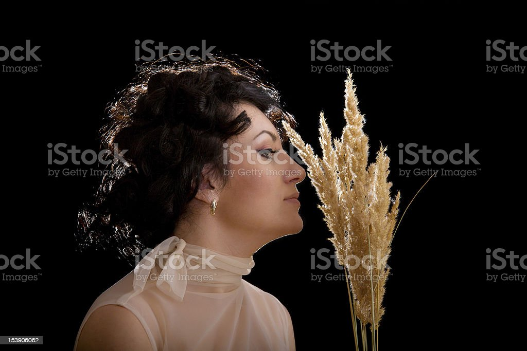 Brunette fashion woman holding spike over black royalty-free stock photo