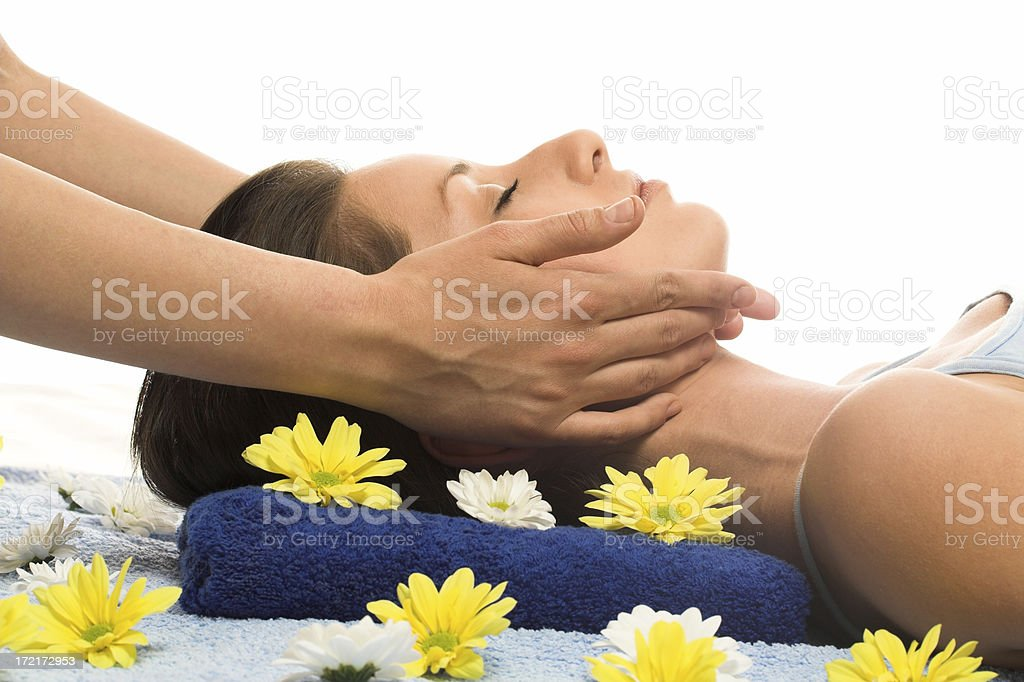 Brunette getting a face massage in the spa salon royalty-free stock photo