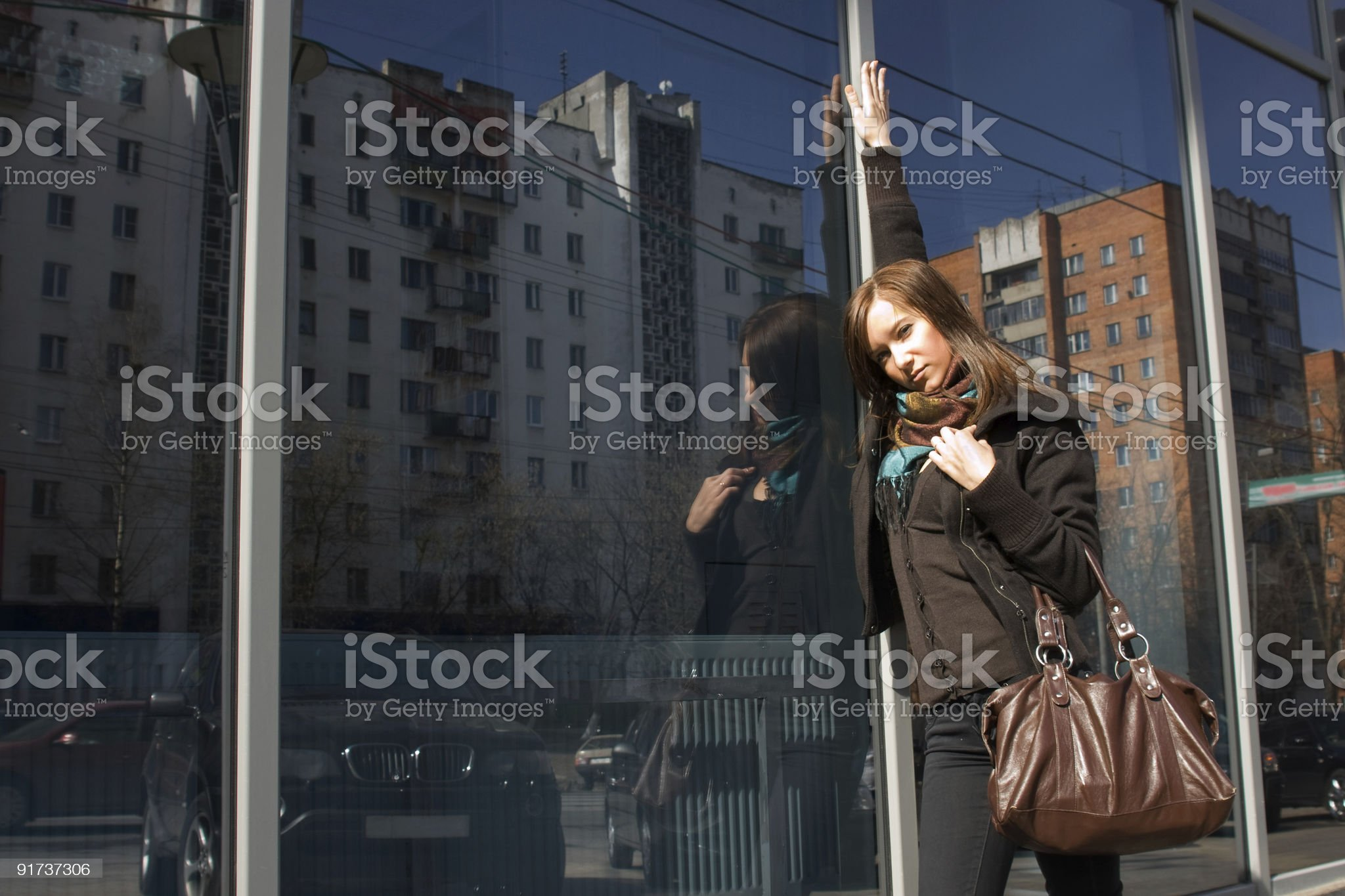 Brunette Girl Near Mirror Wall royalty-free stock photo