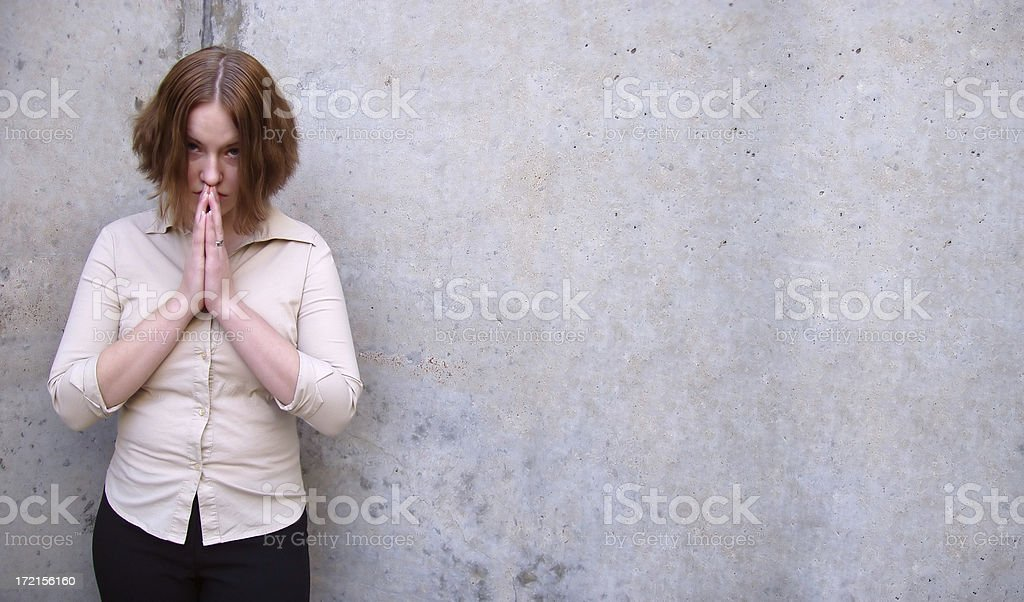 Brunette Girl - Praying in Urban Setting stock photo