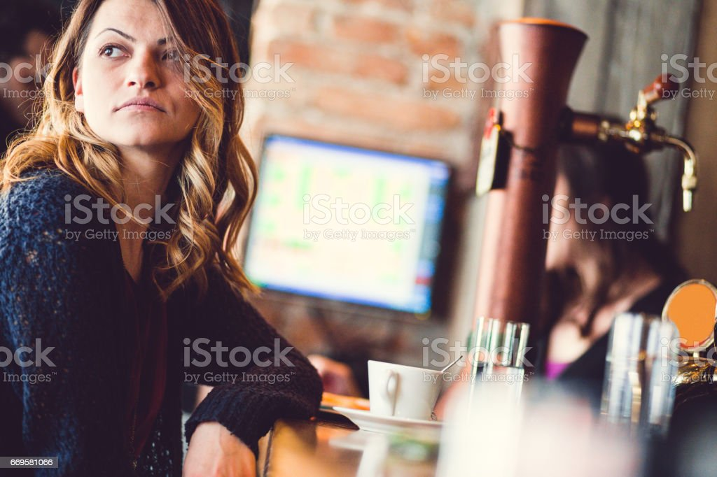 Brunette Girl Waiting For Friends In A Coffee Shop stock photo
