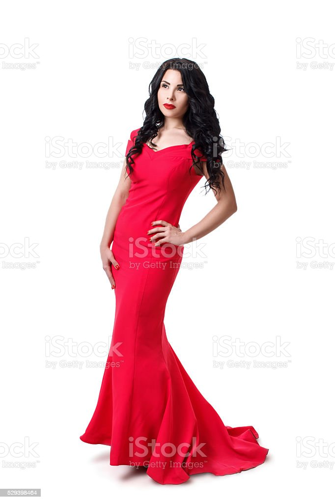 brunette girl with  curly hair in a red evening dress. stock photo