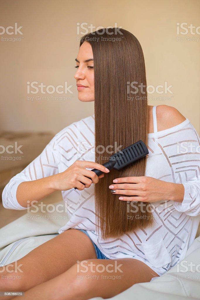 brunette girl with long hair stock photo