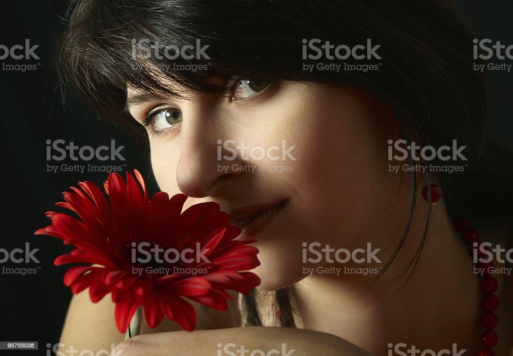 Brunette girl with red flower stock photo