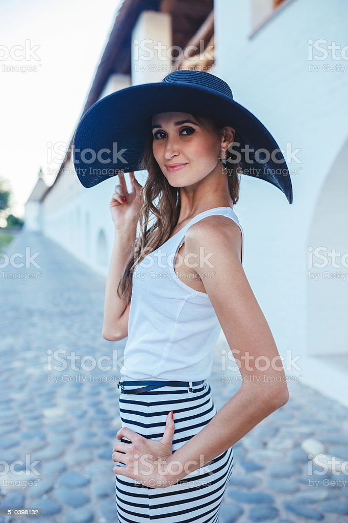 brunette in hat with large fields stock photo