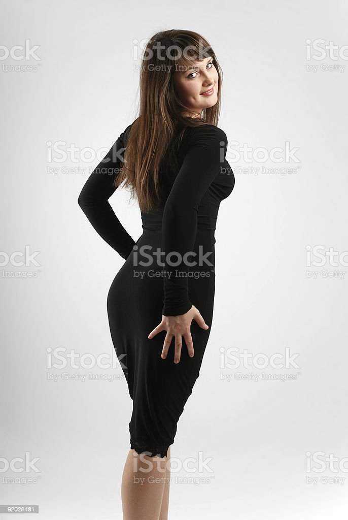 Brunette in slinky black, rear view stock photo