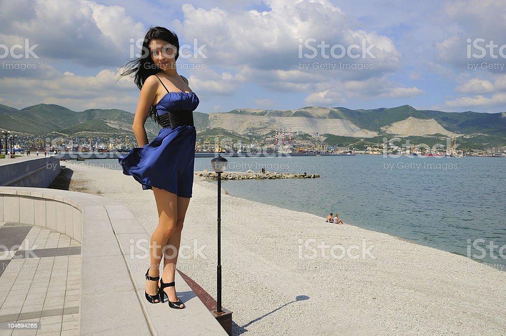 Brunette in the beach stock photo