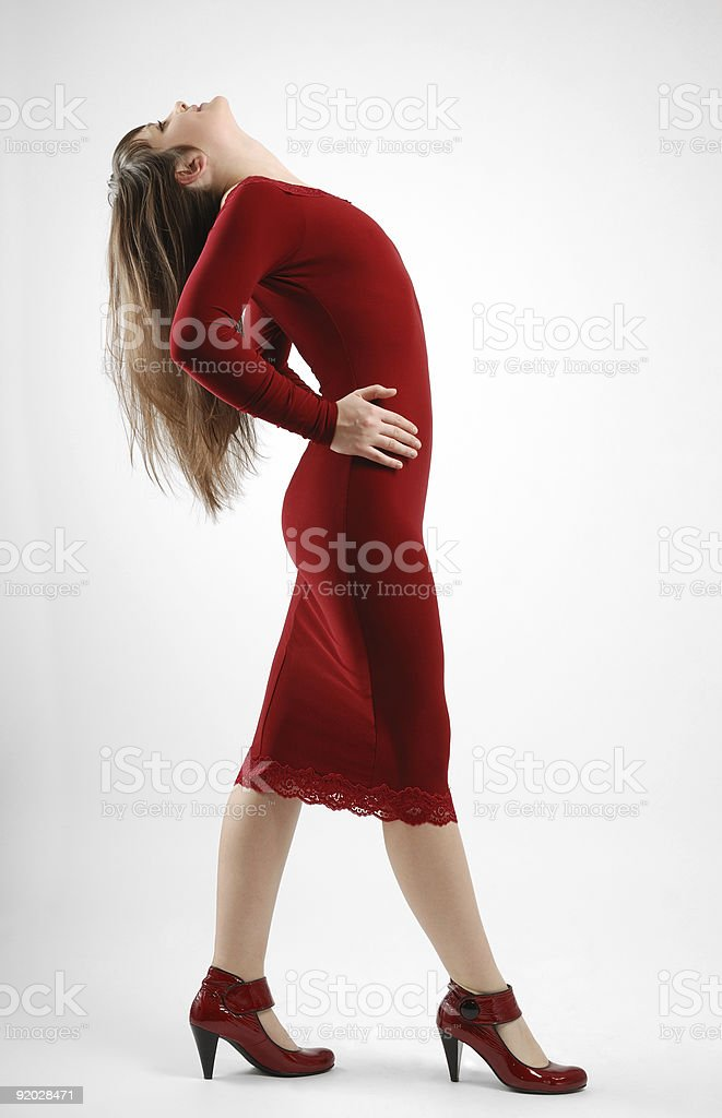 Brunette in vinous arching the back royalty-free stock photo