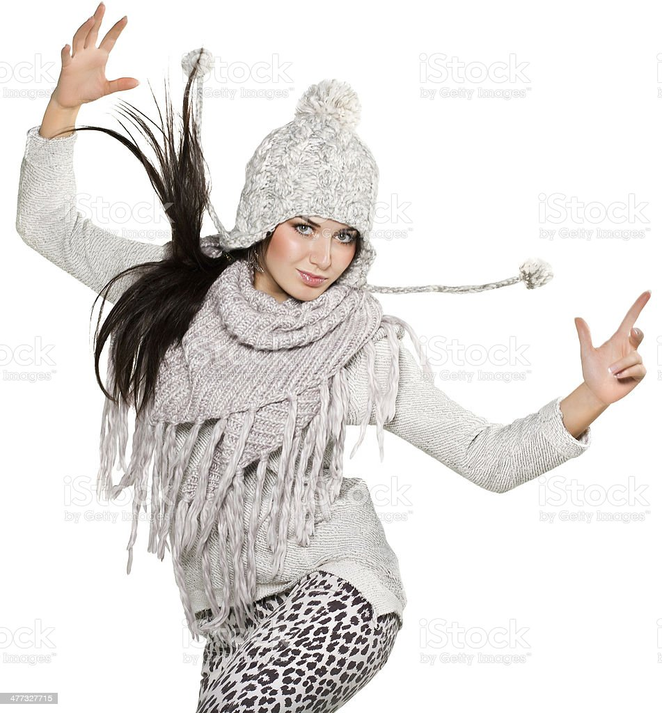Brunette in winter clothes jump on white background stock photo