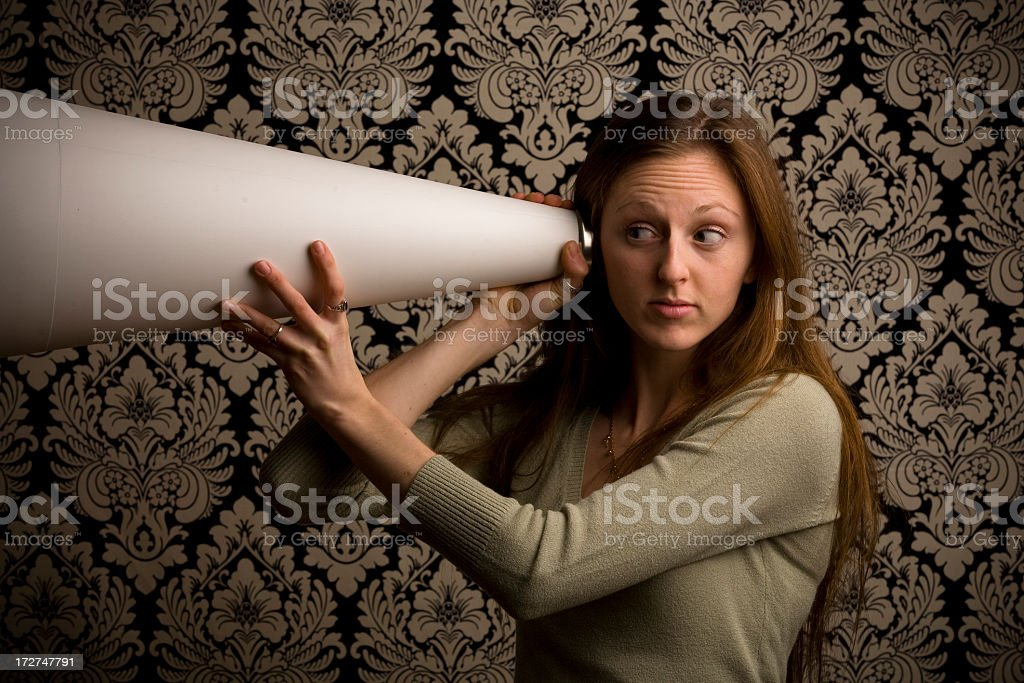 Brunette Listening Through Megaphone stock photo