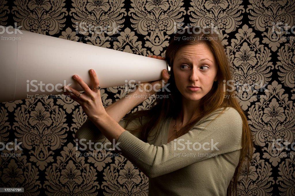 Brunette Listening Through Megaphone stock photo