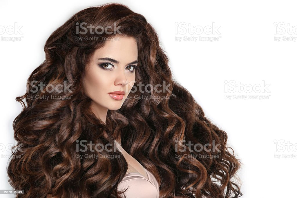 Brunette. Long hair. Curly hairstyle. Beautiful woman stock photo